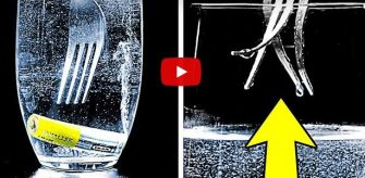 VIDEO – Daca pui sare si o baterie intr-un pahar cu apa poti distruge o furculita – Experiment pe care-l poti face acasa